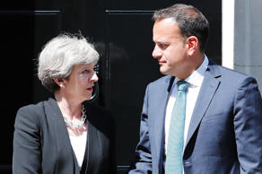 Britain's Prime Minister Theresa May (L) greets Ireland's Taoiseach (Prime Minister) Leo Varadkar before their meeting, outside 10 Downing Street in London on June 19, 2017. Brexit negotiations start in Brussels today. Working groups will be set up to focus on three key areas, which include the future of the Northern Irish border with EU member Ireland.  / AFP PHOTO / Tolga AKMEN        (Photo credit should read TOLGA AKMEN/AFP/Getty Images)