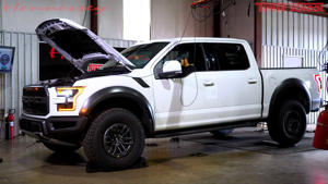 a car parked in front of a building: 2019 Ford Raptor Dyno