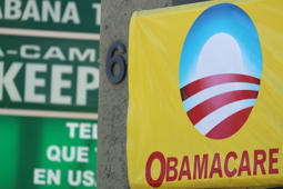 A sign on an insurance store advertises Obamacare in San Ysidro, San Diego, California, U.S., October 26, 2017. REUTERS/Mike Blake