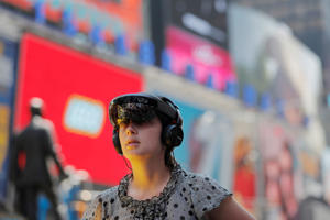 Participant uses a Microsoft HoloLens to look at artist Mel Chin's mixed reality climate change themed art installation, Unmoored, in the Times Square neighborhood of New York U.S., July 11, 2018. REUTERS/Lucas Jackson
