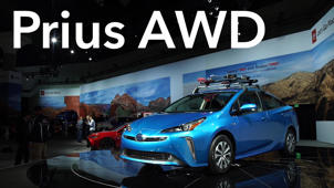 a blue car on display: 2018 LA Auto Show: 2019 Toyota Prius AWD