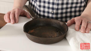 a pan of food on a table: Bring An Old Cast Iron Skillet Back To Life