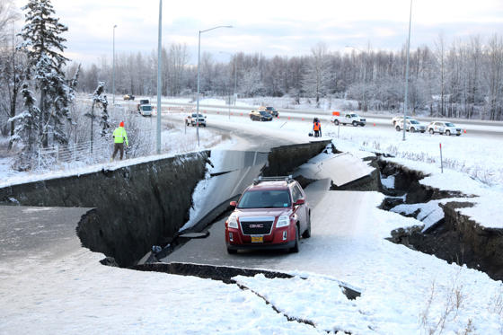 Slide 1 of 24: A vehicle lies stranded on a collapsed roadway near the airport after an earthquake in Anchorage, Alaska, U.S. November 30, 2018.  REUTERS/Nathaniel Wilder