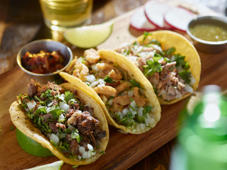 mexican street tacos with barbacoa, carnitas and Chicharrón shot with selective focus