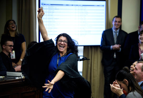 Slide 1 of 36: US Representative-elect Rashida Tlaib (D-MI) reacts to a good number during an office lottery for new members of Congress on Capitol Hill November 30, 2018 in Washington, DC.