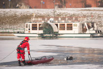 KRAKOW, POLAND - 2018/03/01: A diver is seen rescuing of a man who has fallen into Vistula river while walking on the ice in Krakow. A man fallen to the frozen river as his own weight broken the thin ice as he was walking on the surface, rescue services rushed to save him and he is currently being treated at the hospital. (Photo by Omar Marques/SOPA Images/LightRocket via Getty Images)
