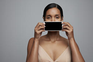 Woman holding tablet in front of different parts of the body. It is possible to purchase hand made coloured illustrations of the body parts in 'x-ray' style, created to fit the screen the images from this shoot.
