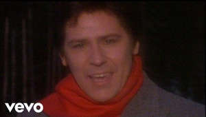 "a close up of a person: More Christmas hits here: https://LegacyRecordings.lnk.to/xmas_pl  Shakin' Stevens' official music video for 'Merry Christmas Everyone'. Click to listen to Shakin Stevens on Spotify: http://smarturl.it/ShakinMulti?IQid=x... As featured on Merry Christmas Everyone. Click to buy the track or album via iTunes: http://smarturl.it/Shakinxmas?IQid=xm...  Google Play: http://smarturl.it/ShakinGP?IQid=xmas.d Amazon: http://smarturl.it/ShakinA?IQid=xmas.d  More from Shakin' Stevens Echoes Of Merry Christmas Everyone: https://www.youtube.com/watch?v=nvN2_... It's Raining: https://www.youtube.com/watch?v=zNfKx... The Best Christmas Of Them All: [https://www.youtube.com/watch?v=03Gn4...  More great Christmas videos here http://smarturl.it/ChristmasHitsVid?I...  Follow Shakin' Stevens: Website: http://www.shakinstevens.com/ Facebook: https://www.facebook.com/shakinsteven... Twitter: https://twitter.com/officialshaky?lan...  Subscribe to Shakin' Stevens on YouTube: http://smarturl.it/Shakinsubscribe?IQ... --------- Lyrics Snow is falling all around me Children playing having fun It's the season of love and understanding Merry Christmas everyone  Time for parties and celebration People dancing all night long Time for presents and exchanging kisses Time for singing Christmas songs  We're gonna have a party tonight I'm gonna find that girl underneath the mistletoe We'll kissed by candlelight  Music video by Shakin' Stevens performing Merry Christmas Everyone. (C) 2005 SONY BMG MUSIC ENTERTAINMENT (UK) LIMITED Best of Shakin' Stevens: https://goo.gl/renJPk Subscribe here: https://goo.gl/qRRvGp""  #shakin stevens #merrychristmas #Christmas #merrychristmaseveryone #christmas music #Christmassongs"