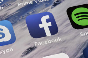 The icon of Facebook is pictured on an iPhone on Thursday, Nov. 15, 2018 in Gelsenkirchen, Germany. (AP Photo/Martin Meissner)