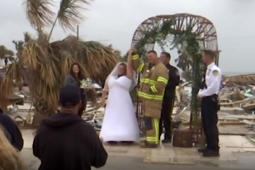 Couple weds on remains of their destroyed home