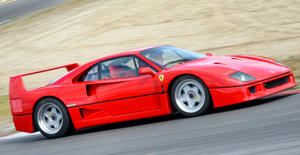 Zandvoort, The Netherlands - June 29, 2014: Red Ferrari F40 1980s supercar driving on the Zandvoort race track during the 2014 Italia a Zandvoort day.