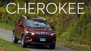 a car parked in the grass: 2019 Jeep Cherokee Quick Drive