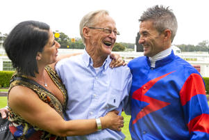 SYDNEY, AUSTRALIA - DECEMBER 05:  Jockey Corey Brown and his wife Kylie Brown hug retiring trainer Bill Prain (C) after race 3, The farewell Bill Prain Handicap during racing at Warwick Farm on December 5, 2018 in Sydney, Australia. (Photo by Jenny Evans/Getty Images)