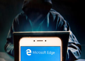 HONG KONG - 2018/11/23: American web browser developed by Microsoft, Microsoft Edge, logo is seen on an Android mobile device with a figure of hacker on the background. (Photo by Miguel Candela/SOPA Images/LightRocket via Getty Images)