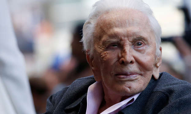 Slide 1 of 20: Actor Kirk Douglas is seen prior to the unveiling of actor Michael Douglas' star on the Hollywood Walk of Fame in Los Angeles, California, U.S., November 6, 2018. REUTERS/Mario Anzuoni