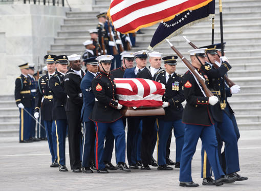Slide 1 of 42: The casket with the remains of former US President George H.W. Bush departs the US Capitol during a state funeral in Washington on Dec. 5, 2018.