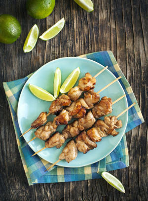a plate of food on a table: Mahogany chicken skewers
