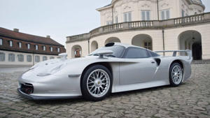 a car parked in front of a building: Porsche Top Five Most Expensive