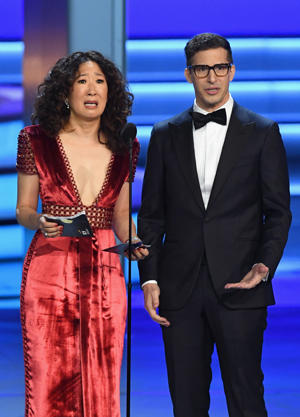 Sandra Oh and Andy Samberg walk onstage during the 70th Emmy Awards at Microsoft Theater on September 17, 2018 in Los Angeles, California.  (Photo by Kevin Winter/Getty Images)