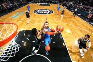 Steven Adams #12 of the Oklahoma City Thunder shoots the ball against the Brooklyn Nets on December 5, 2018 at Barclays Center in Brooklyn, New York.