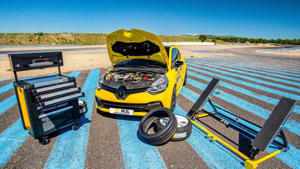 a group of parked motorcycles sitting on top of a sandy beach: Renault RS Performance parts