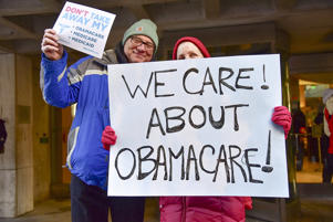 Constituents speak-out and rally supporting the Affordable Care Act, organized by MoveOn.org outside Senator Pat Toomey's office on December 20, 2016 in Philadelphia, Pennsylvania.
