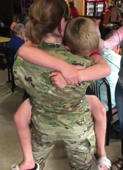 Military mom comes home and son can't stop hugging her
