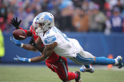 CAPTION: BUFFALO, NY - DECEMBER 16: Kenny Golladay #19 of the Detroit Lions cannot hold on to a pass in the second quarter during NFL game as TreDavious White #27 of the Buffalo Bills plays defense at New Era Field on December 16, 2018 in Buffalo, New York.