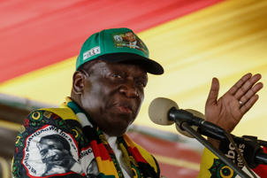 Zimbabwe President and ZANU-PF leader Emmerson Mnangagwa gestures as he delivers the closing remarks at the end of the party's 17th National People's Conference in Esigodini Matebeleland South, on December 15, 2018.