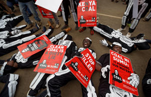 Environmental protesters demonstrate against recent government plans to mine coal and open a coal-fired power plant, in downtown Nairobi, Kenya Tuesday, June 5, 2018