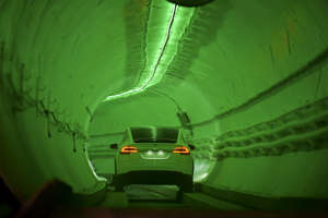 A modified Tesla Model X drives into the tunnel entrance before an unveiling event for the Boring Co. Hawthorne test tunnel in Hawthorne, south of Los Angeles on December 18, 2018. - On Tuesday night December 18, 2018, Boring Co. will officially open the Hawthorne tunnel, a preview of Elon Musk's larger vision to ease L.A. traffic. (Photo by Robyn Beck / POOL / AFP)        (Photo credit should read ROBYN BECK/AFP/Getty Images)