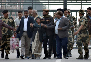 Hamid Ansari (C, wearing cap), an Indian national who was released by Pakistan, meets with his relatives upon his arrival at the Attari-Wagah border, near the northern city of Amritsar, India, December 18, 2018.  REUTERS/Stringer
