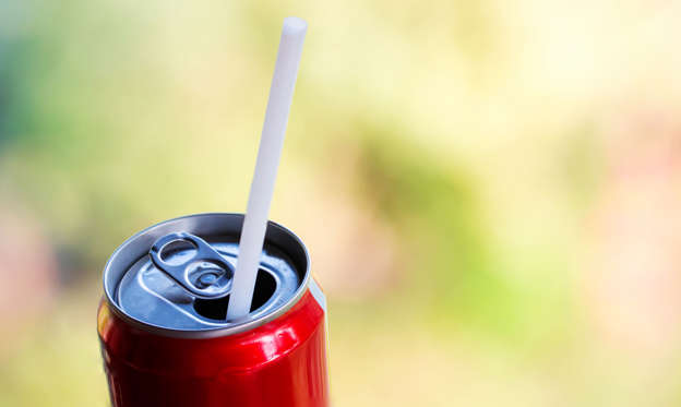 Dia 2/63: Red aluminium can,straw on sparking water can. sweet drinking. un-healthy food concept