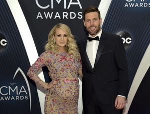 Singer Carrie Underwood and husband Mike Fisher arrive at the 52nd annual CMA Awards at Bridgestone Arena on Wednesday, Nov. 14, 2018, in Nashville, Tenn. (Photo by Evan Agostini/Invision/AP)