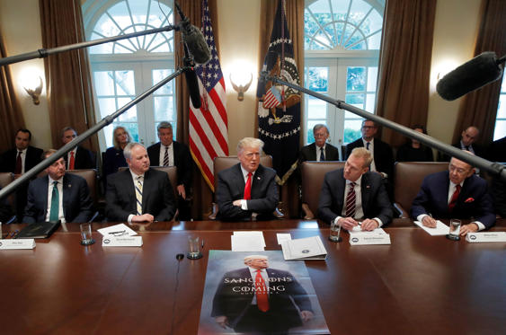 Slide 1 of 50: U.S. President Donald Trump attends a Cabinet meeting on day 12 of the partial U.S. government shutdown at the White House in Washington, U.S., January 2, 2019.