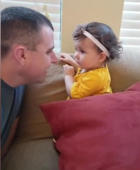Toddler shocked as she sees her dad