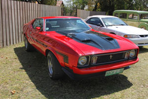 Rustenburg, South Africa - September 17, 2013: A bright red Ford Mustang Mach 1 on display at the half century celebration of the Rusoord old aged home.