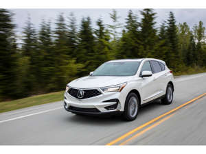 a car driving on a road: 2019 Acura RDX
