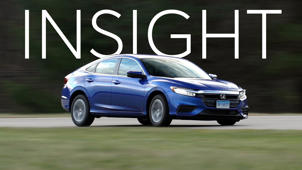 a car parked on the side of a road: 2019 Honda Insight Quick Drive