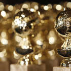 FILE - In this Jan.. 6, 2009, file photo, Golden Globe statuettes are displayed during a news conference in Beverly Hills, Calif. Nominations for the  75th annual Golden Globes will be announced on Monday, Dec. 11, 2017. (AP Photo/Matt Sayles, File)
