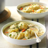 a bowl of food on a plate: The Best Chicken and Dumplings