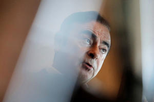 In this Friday, April 20, 2018, photo, Nissan Chairman Carlos Ghosn speaks during an interview in Hong Kong. Nissan Chairman Carlos Ghosn, who became one of the auto industry's most powerful executives by engineering a turnaround at the Japanese manufacturer, was arrested Monday and will be fired for allegedly underreporting his income and misusing company funds, the automaker said. (AP Photo/Kin Cheung)