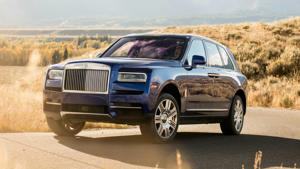 a car parked on the side of a road: Rolls-Royce Cullinan