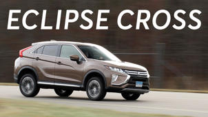 a car parked in front of a sign: 2018 Mitsubishi Eclipse Cross Road Test