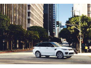 a car driving on a city street: 2019 Land Rover Range Rover Sport