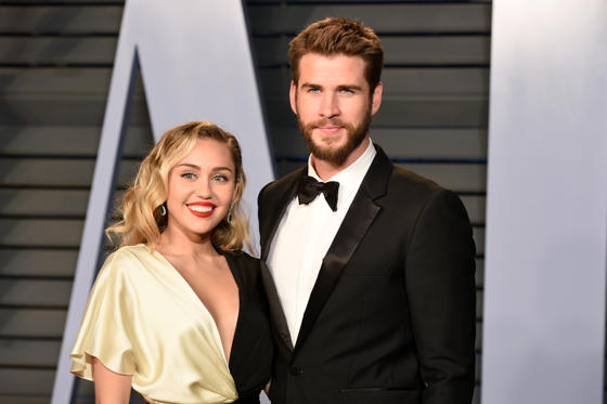 Slide 1 of 102: BEVERLY HILLS, CA - MARCH 04:  Miley Cyrus and Liam Hemsworth attend the 2018 Vanity Fair Oscar Party Hosted By Radhika Jones - Arrivals at Wallis Annenberg Center for the Performing Arts on March 4, 2018 in Beverly Hills, CA.  (Photo by Presley Ann/Patrick McMullan via Getty Images)