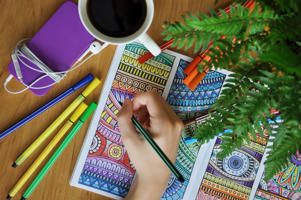 Colouring an anti-stress colouring book for adults