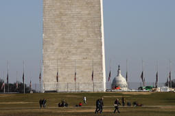 People walk near the Washington Monument, with the U.S. Capitol in the background, Wednesday, Dec. 26, 2018, as the partial government shutdown continues in Washington. A shutdown affecting parts of the federal government appeared no closer to resolution Wednesday, with President Donald Trump and congressional Democrats locked in a hardening standoff over border wall funding that threatens to carry over into January. (AP Photo/Jacquelyn Martin)
