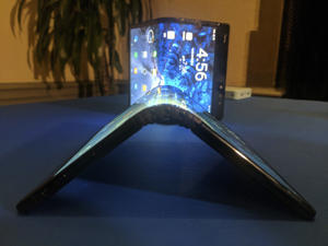 In this Monday, Nov. 5, 2018, photo is a FlexPai smartphone with a flexible screen displayed in San Francisco. Royole Corp. recently unveiled what it is billing to be the world's first smartphone with a flexible screen so the device can be folded like a billfold. The phone will go on sale next month in China only, but Royole hopes to release it in the U.S. next year. Samsung announced its plans for its own foldable-screen phone in San Francisco on Wednesday. (AP Photo/Michael Liedtke)