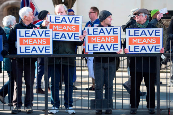 Slide 1 of 32: TOPSHOT - Activists hold up placards from the Leave Means Leave Pro-Brexit campaign group outside the Houses of Parliament in London on Janaury 8, 2019. - British MPs are set to hold a critical vote on January 15 on the Brexit agreement negotiated by Prime Minister Theresa May, her spokesman said on January 8. (Photo by Niklas HALLE'N / AFP)        (Photo credit should read NIKLAS HALLE'N/AFP/Getty Images)